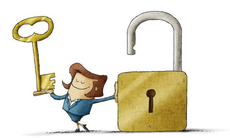 Woman holding key to unlock padlock